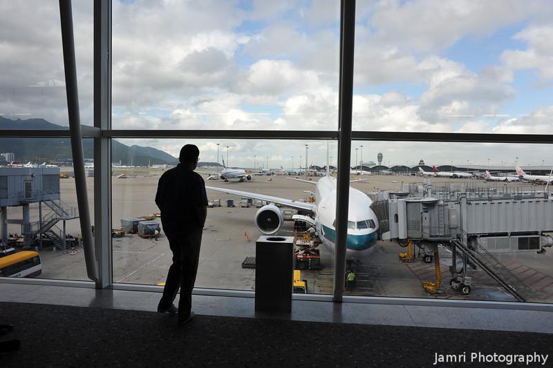Watching the Planes.<br /> At Hong Kong Airport.