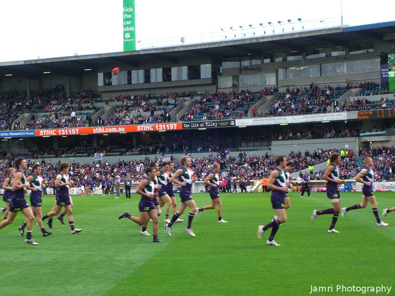 The Dockers Run Past.<br /> On a warm up lap before the game.