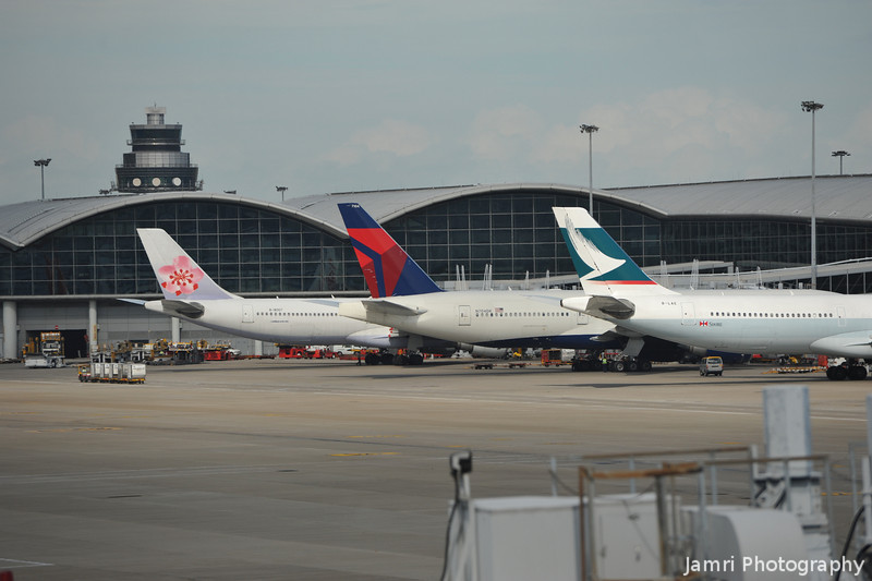 Three tails.<br /> China Airlines, Delta, and Cathay Pacific.