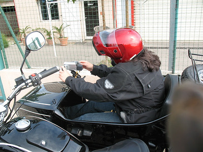 We had a Panasonic Palmcorder mounted to the sidecar hand hold with a RAM mount