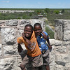 Children posing atop the lookout tower at Okaukueho Rest Camp, Etosha NP, Namibia