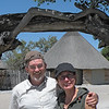 Kim and Alan at the entrance to the guest cabin area by the waterhole at Okaukuejo Rest Camp, Etosha NP, Namibia