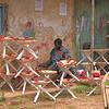 A man painting tripod serving baskets.