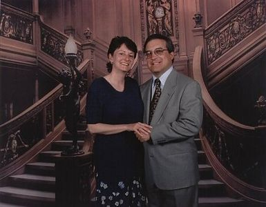 The realistic looking grand staircase behind us is actually just a backdrop used by the ship's photographers. The photo turned out looking much more real than in real life!