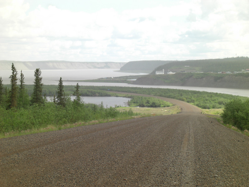 approaching the mackenzie river on the dempster (the town of artic red river on the hill)