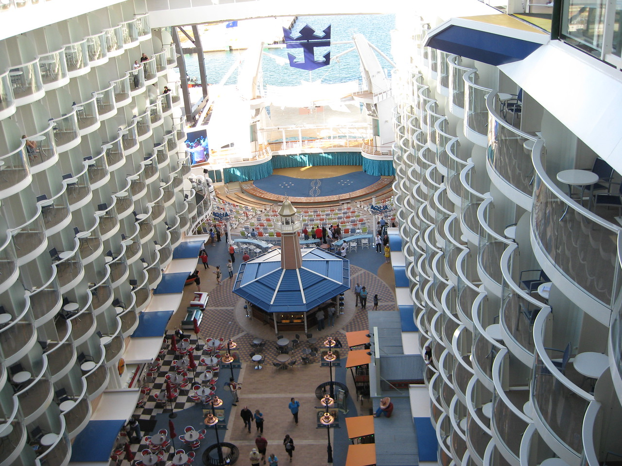 From deck 16, looking down on the Boardwalk on deck 6.  Beyond the Royal Caribbean symbol you can see the sea behind the ship.