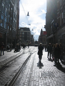 Amsterdam  - narrow street that allows only pedestrians and trams