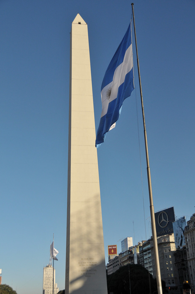 The obelisk is located in the center of the Plaza de la República (Republic Square), the spot where the Argentine flag was flown for the first time in Buenos Aires, at the intersection of Nueve de Julio and Corrientes avenues. Its total height is 67 meters (220 ft) and its base area is 49 square meters (530 square feet).