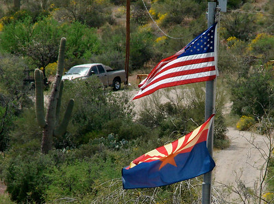 April 17, 2010 - (Boyce-Thompson Arboretum State Park [parking lot] / Superior, Pinal County, Arizona) -- Arizona State Flag flying under the U.S. Flag