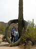 April 18, 2010 - (Saguaro National Park [West] / Tucson, Pima County, Arizona) -- Ken & Connie wrapped in the arms of a Giant Saguaro Cactus