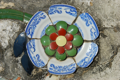 Typical decorations around the outisde of the Temple of Dawn; cut dinner plates and other ceramics to create an interesting flower look