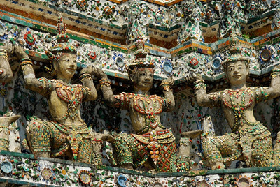 Close view of Wat Arun Ratchawararam (Temple of Dawn); appears these features are holding the temple