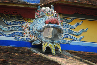 Even the roof drain sprouts have clever decorations at Tu Duc tomb near Hue, Vietnam