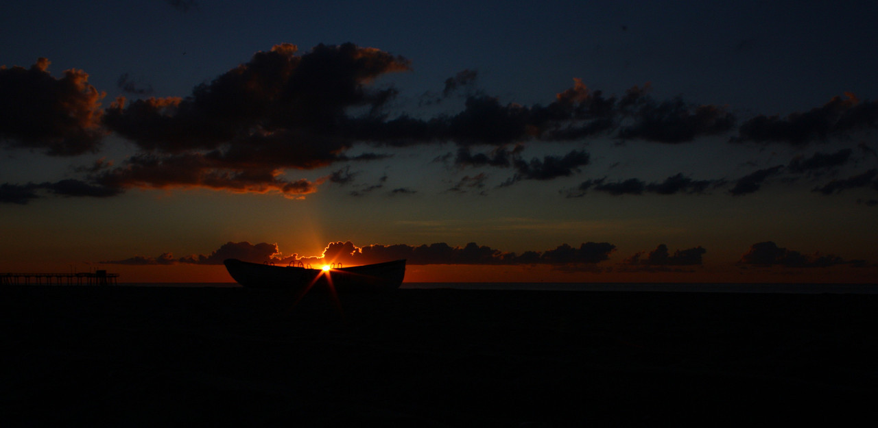 Sunrise on the beach in Avalon, New Jersey with a lifeguard boat.