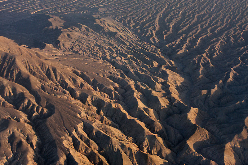 The Atacama Desert us a narrow strip of desert along the northwest coast of Chile to the west of the Andes.  Here is a view from the plane on the way to Calama from Santiago.