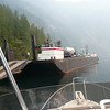 Propane delivery for Rangers Cabin at Chatterbox Falls, big barge. Good skipper of tug.