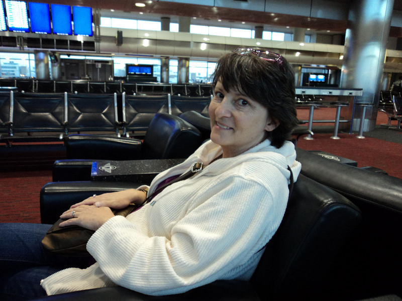 Wendy waiting for our flight out of DIA, after a long day trying to get out of town (4/11/11).