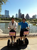 Rick & Wendy on the Segways with the downtown Austin skyline.