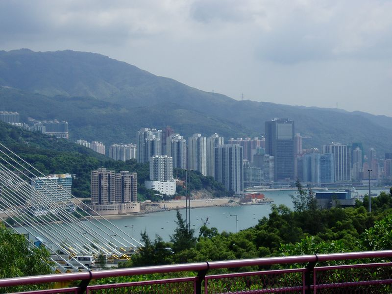 Hong Kong consists of high skyscrappers  along the edge of the mountainous islands, which provide a green background to the city.