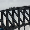 people climbing to the top of the bridge