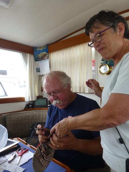 Keith repairs Penny's sandal