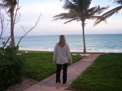 "Holly's checking out the view outside of our ""Lanai Suite"".  Palm trees, beach, ocean, can't beat that."