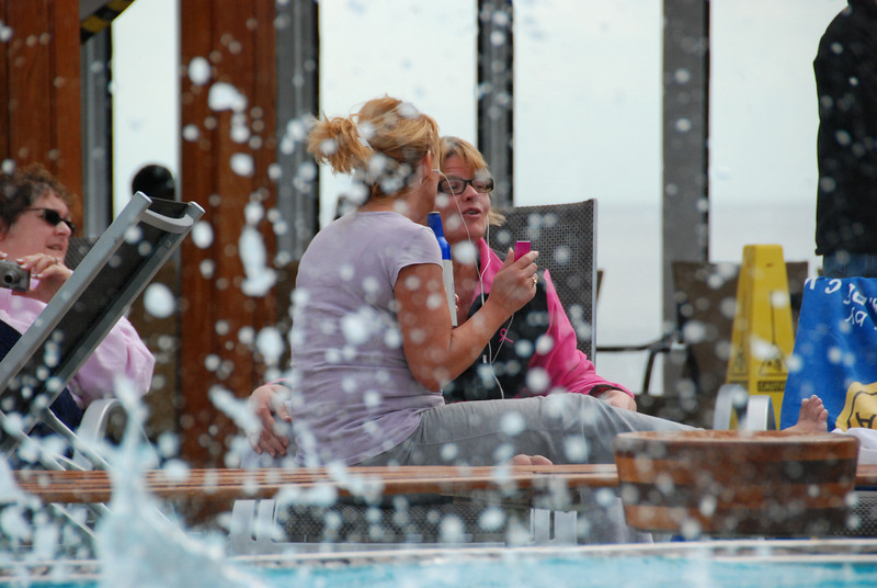 These two women were REALLY enjoying their iPod by the pool