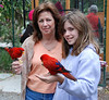 Zena and Sophia feeding the parrots. They and Zena's mother were seated at our table for dinner.