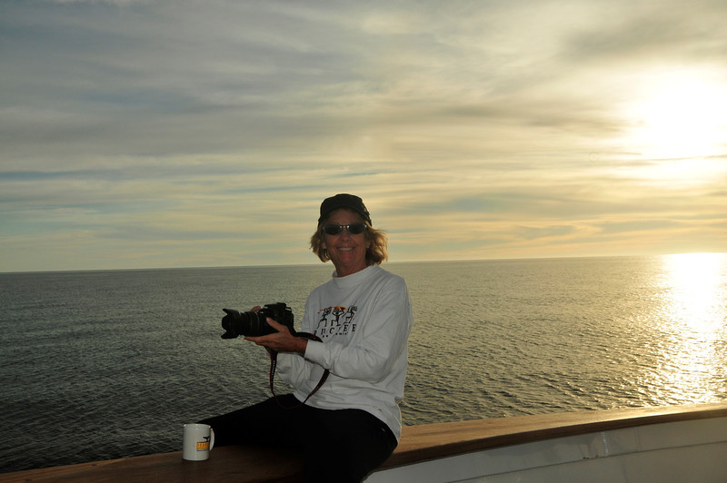Val and Sunrise off the Bow of Searcher