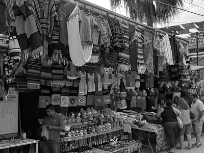 Walking the street of Puerto Nuevo in black and white
