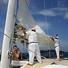 Lowering the mainsail as we approach Nusa Lembongan
