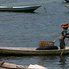 Many of the farmers use an inner tube to float the open-weave basket as they harvest the seaweed.
