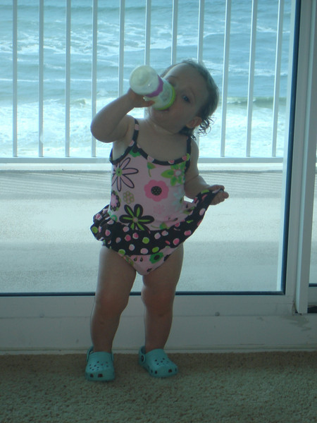 Reese downing her milk, showing off her bathing suit.