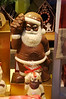 A foot high chocolate Papa Noel in a chocolate shop in Aywaille