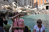 Tossing coins for luck at the Trevi Fountain in Roma.