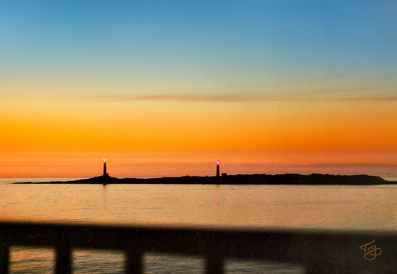"""After disembarking from the ferry in Gloucester, we rode to <a href=""""http://www.edenpinesinn.com/"""" target=""""_blank"""">Eden Pines Inn</a> in Rockport, where we were treated the next morning to this sunrise over the twin lighthouses, stalwart sentinels of Thatcher Island."""