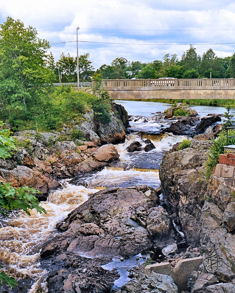 "Machias, Maine - Bad Little Falls - <br /> <br /> The name, Machias, comes from the Passamaquoddy word, ""Machises,"" which roughly translates to ""Bad Little Falls"", the name of these falls."