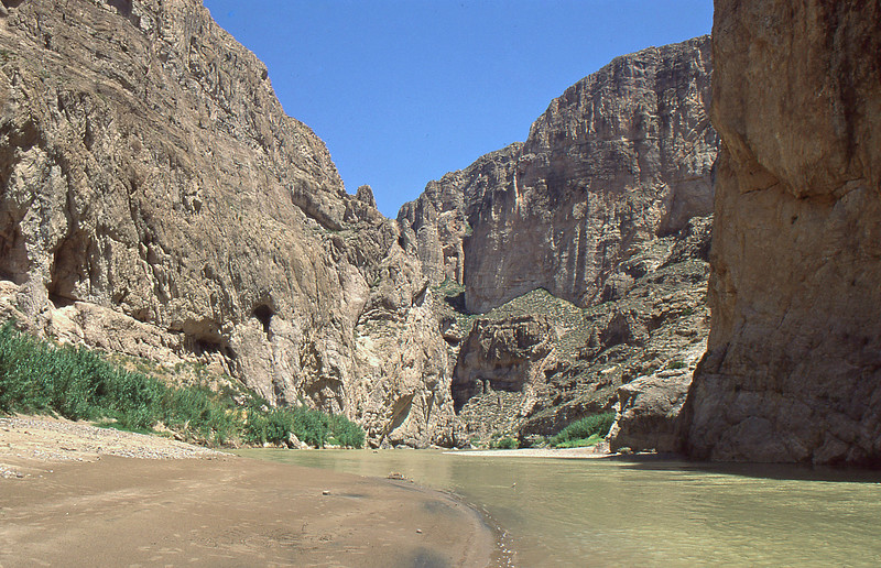 Along the sand bank of the canyon.