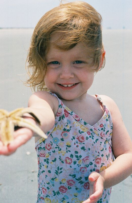 Our 3 year old beauty Elizabeth with her starfish friend!