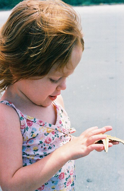 """Elizabeth with her starfish!  She loved to feel the """"legs"""" moving underneath."""