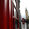 Big Ben in real life and reflected in the glass of one of the famous red phone booths.
