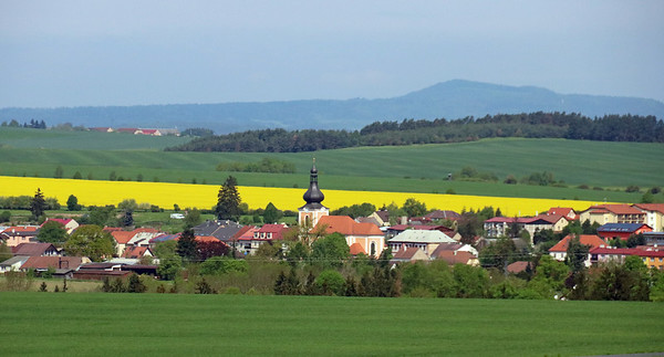 The picturesque little town of Kladruby along the highway with rape fields in the distance.