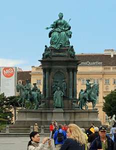 At the center of the square is a large statue depicting Empress Maria Theresa, namesake of the square.