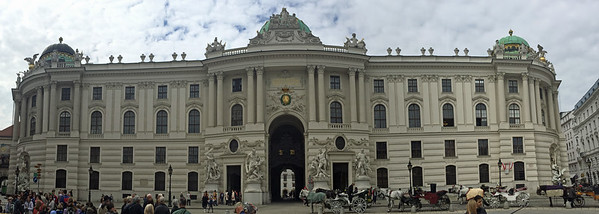 The Michaelertor Gate and St. Michael's wing of the Hofburg Palace as seen from Michaelerplatz Square.