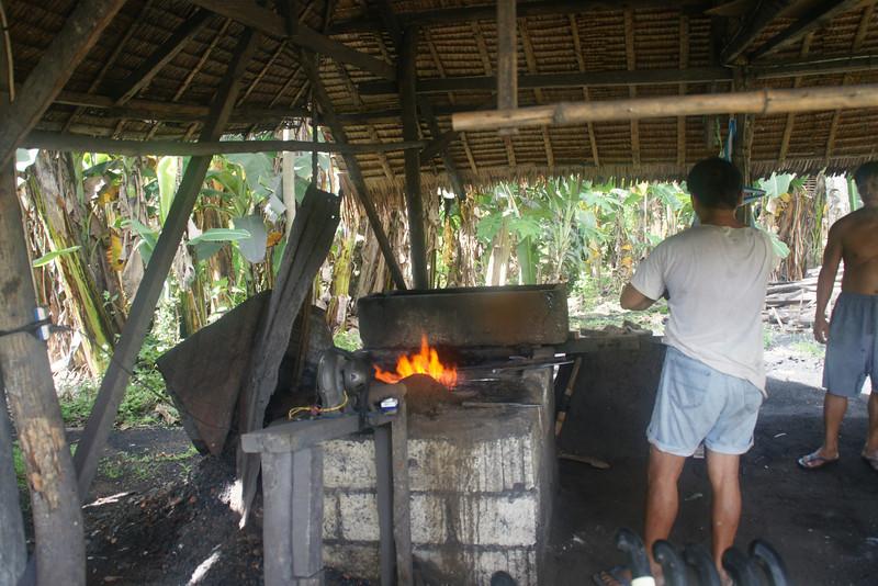 Blacksmith making knives