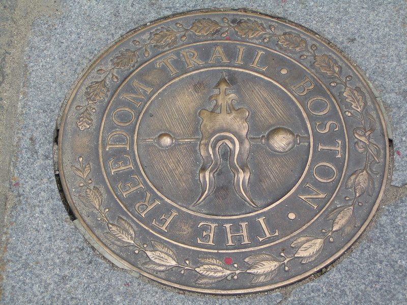 The Freedom Trail was marked by a painted or brick red line going down the sidewalk and these plaques set into the sidewalks.