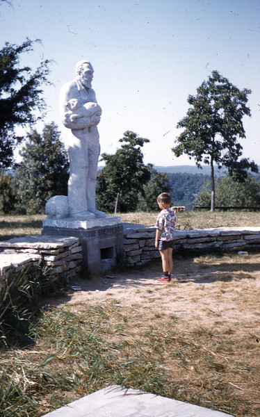 William A. Shaffer looking at Statue.
