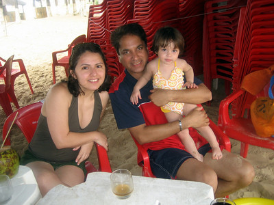 With Mommy and Daddy.