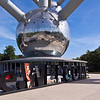 Bruxelles - Belgique<br /> Atomium<br /> <br /> The Atomium is a monument in Brussels, originally built for Expo '58, the 1958 Brussels World's Fair. Designed by André Waterkeyn, it stands 102 metres (335 ft) tall. It has nine steel spheres connected so that the whole forms the shape of a unit cell of an iron crystal magnified 165 billion times.<br /> Tubes connect the spheres along the 12 edges of the cube and all eight vertices to the centre. They enclose escalators connecting the spheres containing exhibit halls and other public spaces. The top sphere provides a panoramic view of Brussels. Each sphere is 18 metres in diameter. Three spheres are currently (2008) closed to visitors, others can be reached easily by escalators. The vertical vertex contains a lift which was very fast and advanced at the time of building (the speed is 5 m/s).