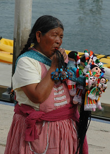 This Mexican local was blowing her whistle and selling dolls, a tough job!